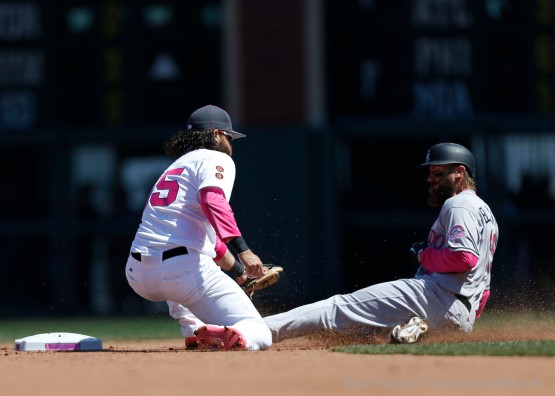 Brandon Crawford tags out Charlie Blackmon attempting to steal second base.