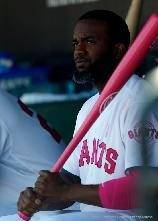 Denard Span watches from the dugout.