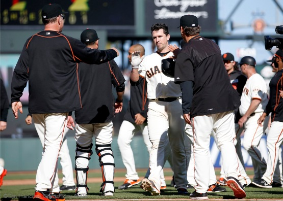 Buster Posey is greeted with high fives after drawing the game winning walk.