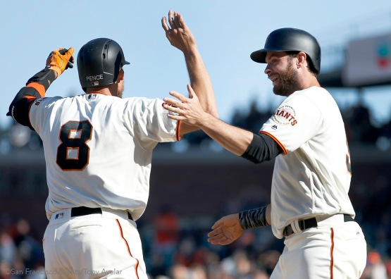 Hunter Pence and Brandon Belt celebrate after Buster Posey drew a walk to win the game.