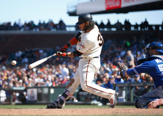 Brandon Crawford singles in the tenth inning.