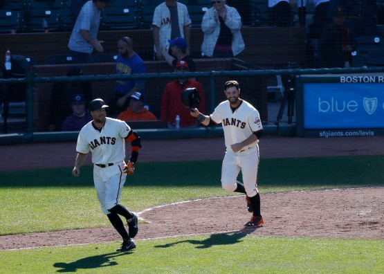 Hunter Pence and Brandon Belt celebrate after Buster Posey drew a game winning walk.