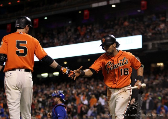 Angel Pagan celebrates after scoring on a single hit by Joe Panik in the third inning.