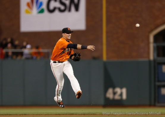 Joe Panik throws out Miguel Montero in the eighth inning.