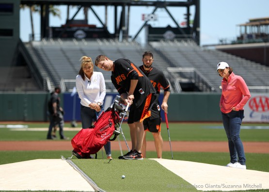 Matt Cain attempts to sink a putt from the mound to home plate.