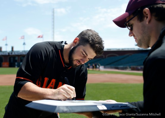 George Kontos signs the home plate the group attempted to putt to.