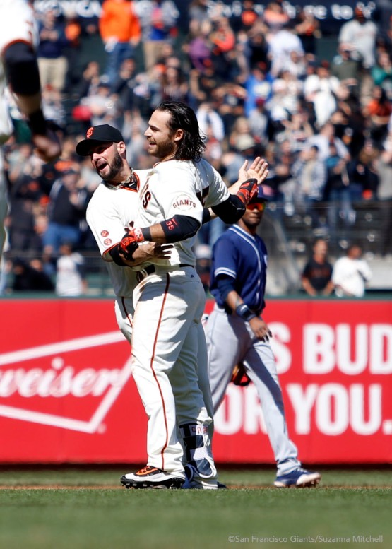 George Kontos and Brandon Crawford celebrate after Crawford hit the game winning single.