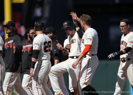 Matt Duffy celebrates after scoring the game winning run in the tenth inning.
