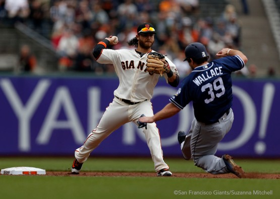 Brandon Crawford tags out Brett Wallace and throws out Derek Norris in the second inning.
