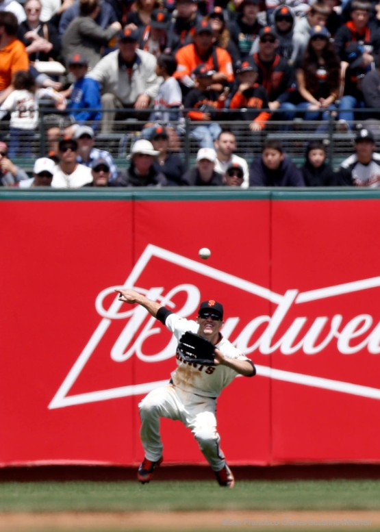 Kelby Tomlinson catches a ball lined to left field hit by Matt Kemp in the sixth inning.