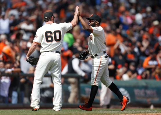 Hunter Strickland high fives Denard Span after he made a catch in center field to end the eighth inning.