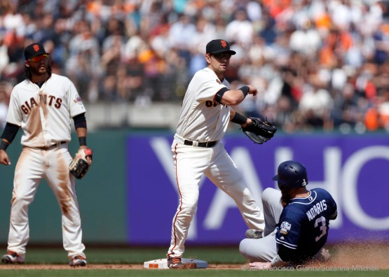 Joe Panik tags out Derek Norris and throws out Alexei Ramirez in the ninth inning.