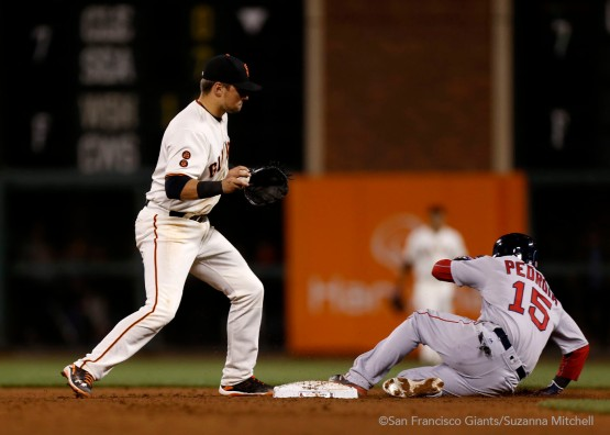 Joe Panik tags out Dustin Pedroia in the eighth inning.