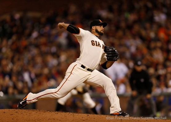 George Kontos pitches in the seventh inning.