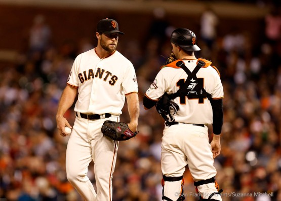Hunter Strickland and Trevor Brown talk on the mound during the eighth inning.