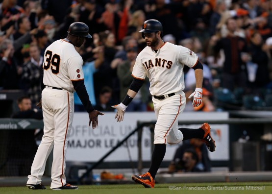Roberto Kelly high fives Brandon Belt after he homered in the fourth.