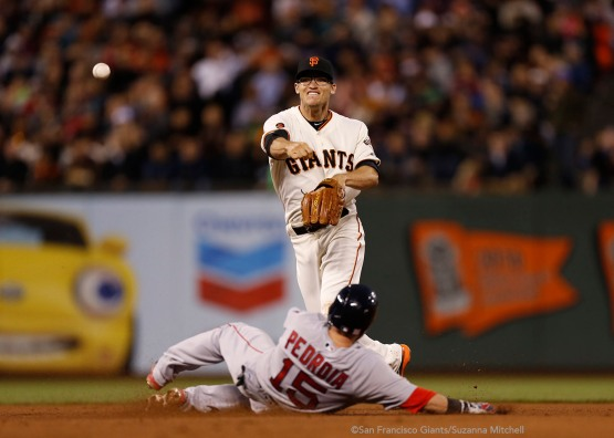 Kelby Tomlinson tags out Dustin Pedroia at second base and attempts to throw out Xander Bogaerts in the sixth inning.