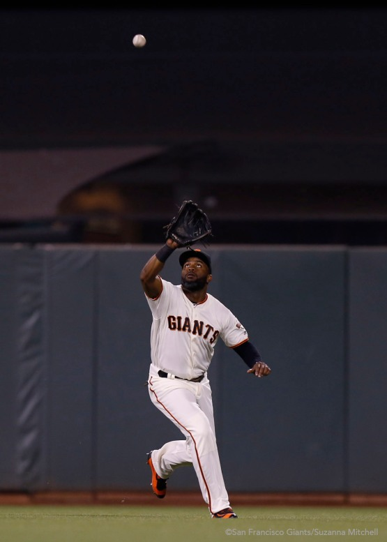 Denard Span catches a fly ball in center field hit by Travis Shaw in the seventh inning.