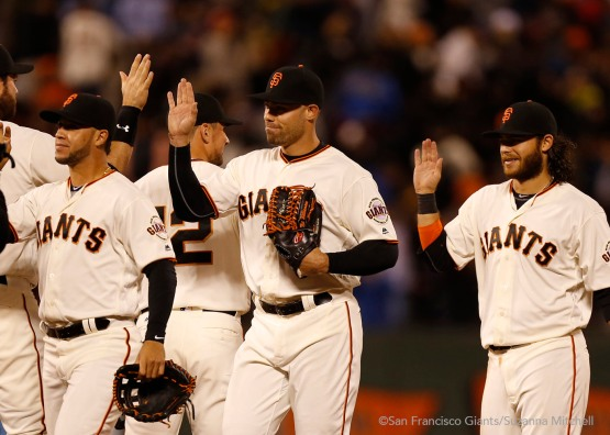 Gregor Blanco, Mac Williamson and Brandon Crawford celebrate after the game.