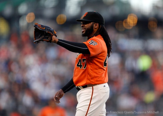 Johnny Cueto pitches in the first inning.