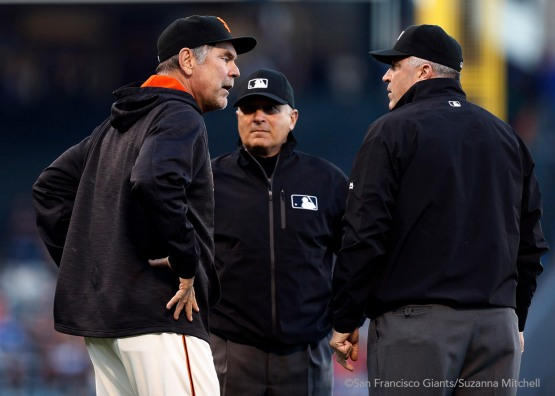 Bruce Bochy argues with the umpires after Johnny Cueto is called for a balk.