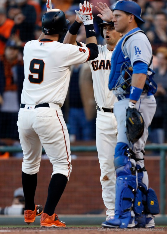 Brandon Belt hight fives Joe Panik after hitting a home run in the sixth inning.