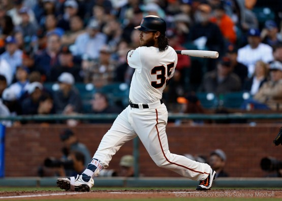 Brandon Crawford triples during the seventh inning.
