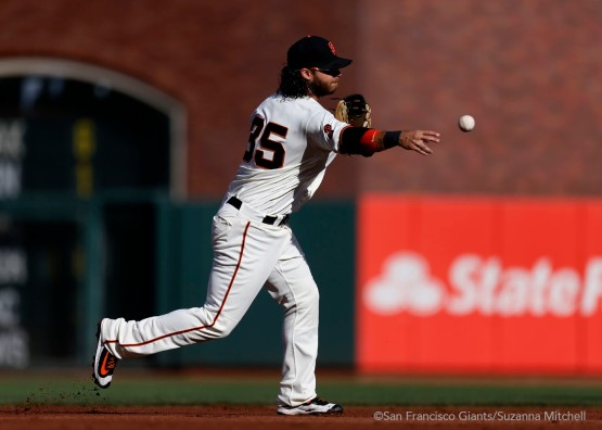 Brandon Crawford throws out Howie Kendrick in the second inning.