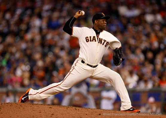Santiago Casilla pitches in the ninth inning.