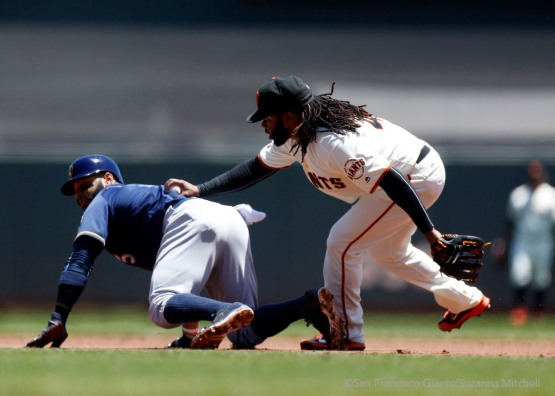 Johnny Cueto tags out Jonathan Villar attempting to steal second base in the first inning.