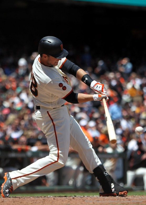 Buster Posey singles in the fourth inning.