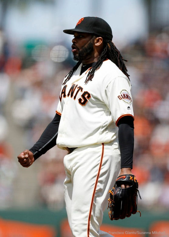Johnny Cueto celebrates after getting a strike out to end the seventh inning.