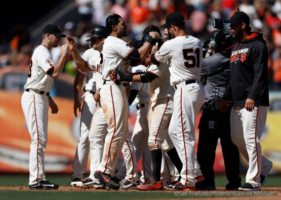 The team celebrates after Conor Gillaspie hit a walk off double to score Ramiro Pena in the ninth inning.