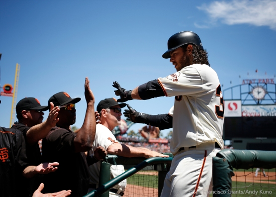Brandon Crawford celebrates as he scored after Conor Gillaspie was hit by a pitch in the third inning.