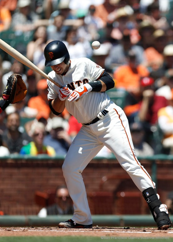 Buster Posey is hit by a pitch in the first inning.
