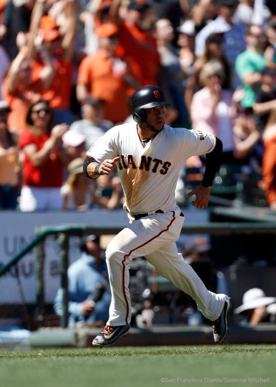 Gregor Blanco scores on a double hit by Angel Pagan in the seventh inning.