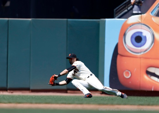Angel Pagan catches a ball lined to left field by Andres Blanco during the sixth inning.