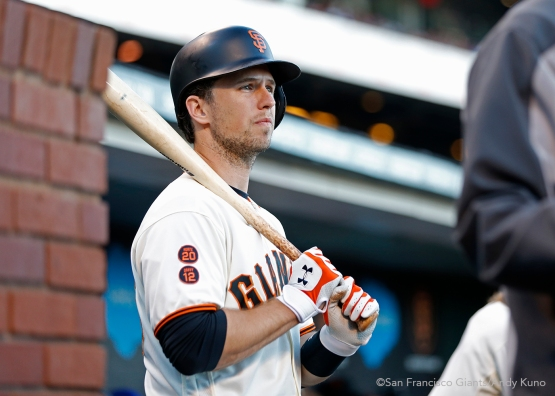 San Francisco Giants Buster Posey waits for his turn to hit.