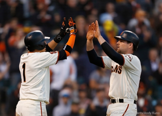 Ramiro Pena and Conor Gillaspie celebrate after scoring on a single hit by Angel Pagan in the fourth inning.