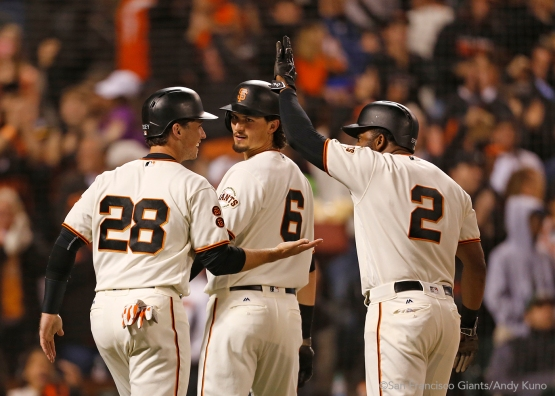 Buster Posey, Jarrett Parker and Denard Span celebrate after scoring on a triple hit by Brandon Crawford in the sixth inning.