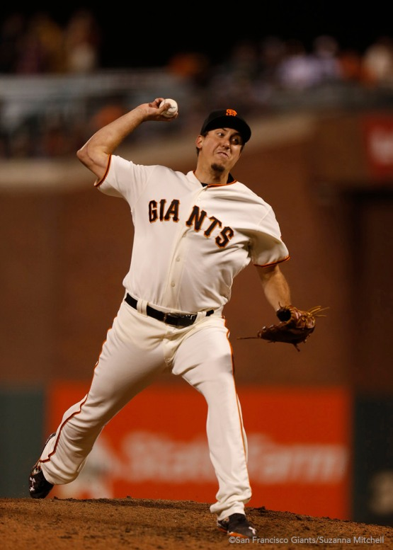 Derek Law pitches in the eighth inning.