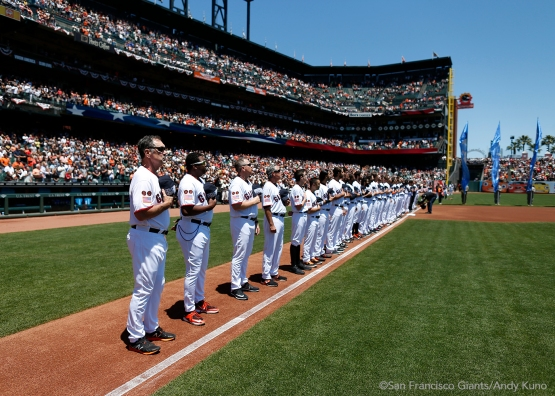 The Giants observe the National Anthem.