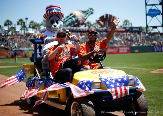 Lou Seal shows his patriotism before the game.
