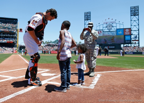 Active and reserve members of the military take the field with the Giants at the start of the game.