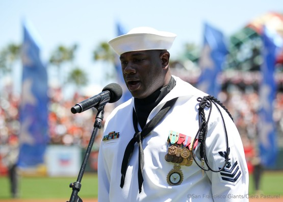 Retired United States Navy Petty Officer First Class Steven Powell performs the National Anthem.