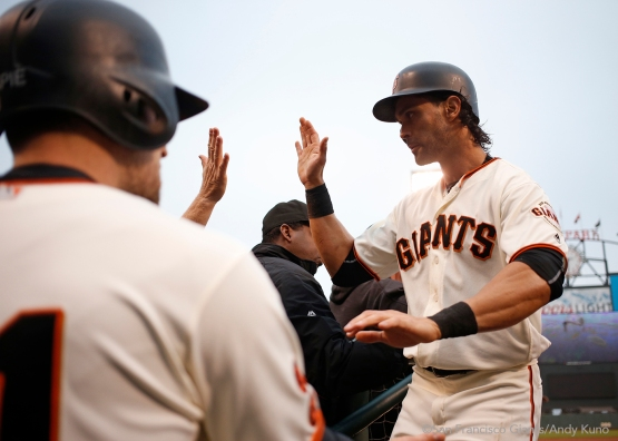 Angel Pagan celebrates after scoring on a single hit by Brandon Belt during the first inning.