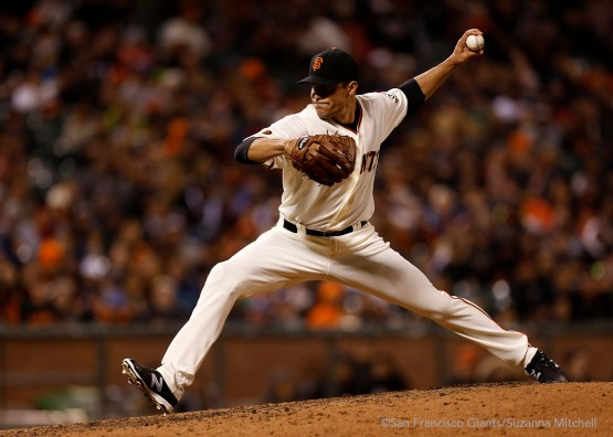 Javier Lopez pitches in the seventh inning.