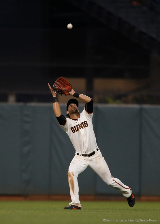 Angel Pagan catches a fly ball in center field hit by Charlie Blackmon during the fifth inning.