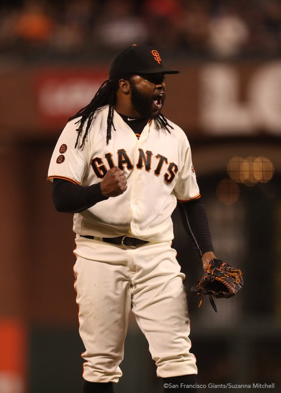 Johnny Cueto celebrates after pitching through the eighth inning.