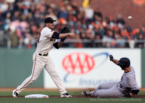 Grant Green tags out D.J. LeMahieu and throws out Nolan Arenado in the first inning.
